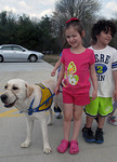 Chili, a service dog in training, stands with preschoolers at Medina Weekday Preschool during a fire drill Tuesday, April 30, 2013. Chili visits the preschoolers every Tuesday and Thursday t …