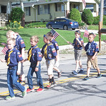 ELIZABETH DOBBINS / GAZETTE Cub Scout Pack 3520 marches in the Hinckley Township Memorial Day Parade.
