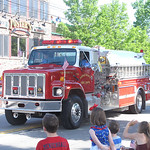 ELIZABETH DOBBINS / GAZETTE Spectators wave at a Hinckley fire truck as it passes during the Township's Memorial Day Parade.