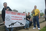 "Northeast Ohio Carry supporters and members pose at an ""open carry"" firearms demonstration walk on Saturday afternoon. (DAVID KNOX / GAZETTE)"