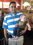 Timothy Watson, of Akron, carries his 4-month-old son, Noah Watson, at a monthly meeting of Ohio Carry's Northeast chapter held at Bob Evans in Medina. Watson carried a sidearm while his son …