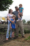 Jeremiah Frame, treasurer of Ohio Carry, poses with his wife, Ohio Carry's Northeast branch President Nicole Frame, and their children, 5-year-old Katelin and 7-year-old Allan. The Frame fam …
