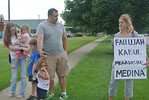 Ohio Carry President Brett Pucillo, of Kent, with his daughter Addison, 2, debates Ohio's law allowing the open display of firearms with Angie Kovacs, of Medina, who was a candidate for the  …